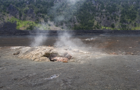 Steam escaping from a hole in the kilauea crater photo