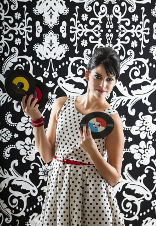 young woman with stylist clothes with three small record photo