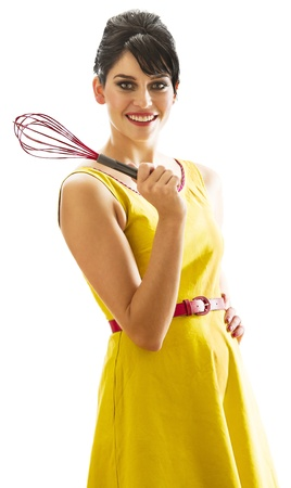 young woman with 60's inspired style, holding a red whisk Archivio Fotografico