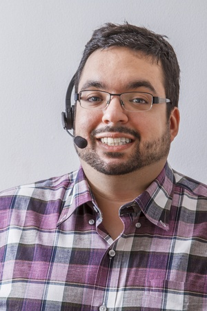 Overweight man with headset against a white background