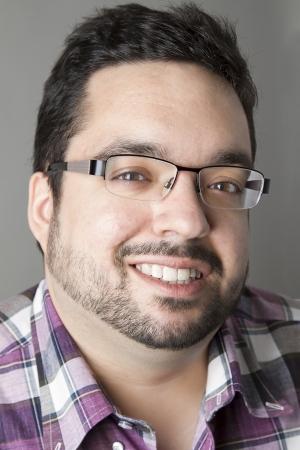 twenty year old man with a corner smile photo