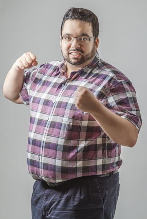 chubby: Young man with his fist up ready to fight