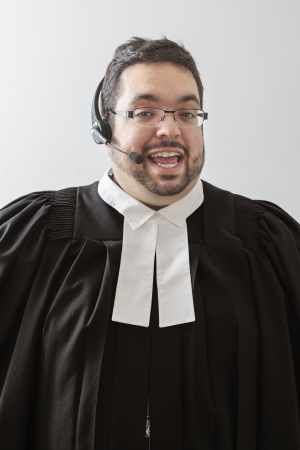Overweight man in canadian lawyer toga talking into a headset  photo