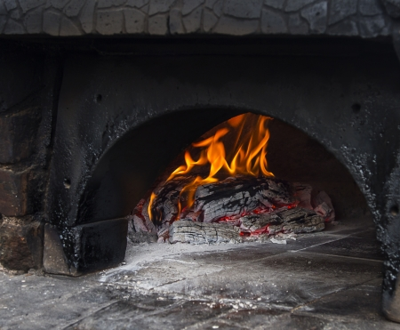woodfire: Wood burning in a pizza oven Stock Photo