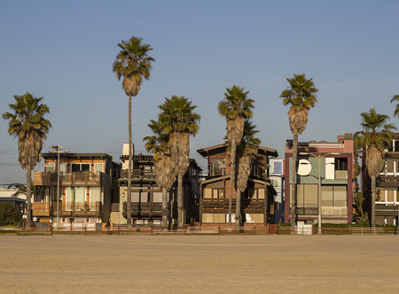 houses on the venice beach at sunset photo