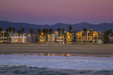 houses on the venice beach at the end of a sunset Stock Photo