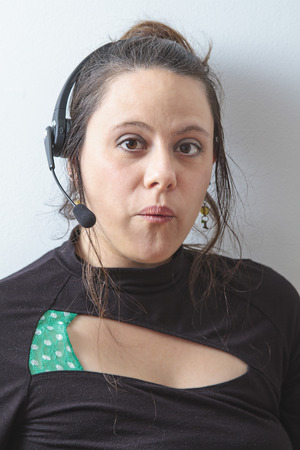 thirty something phone agent with headset with suprise expression 版權商用圖片