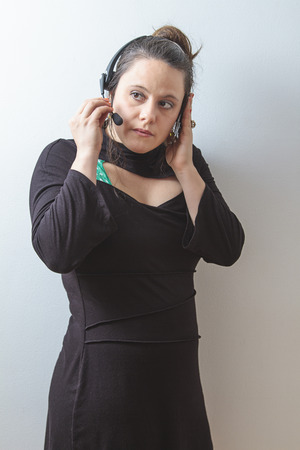 thirty something phone agent with headset concentrating on the conversation