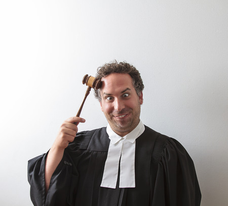 canadian attorney clowning around and banging the gavel on his head