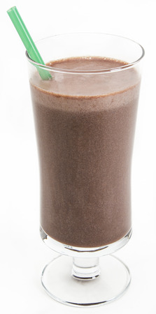 Chocolate milkshake with a green straw against a white background Archivio Fotografico
