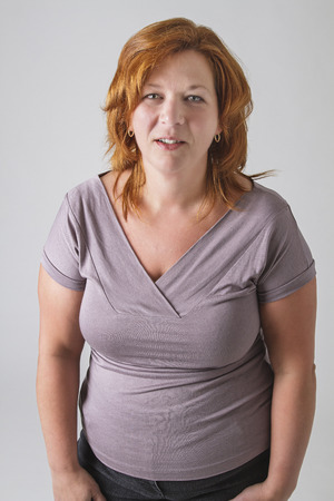 round woman in her forties with red hair