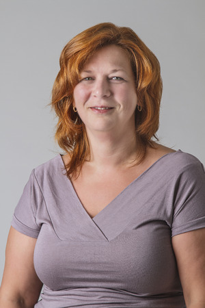 Forty year old woman with red hair