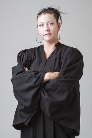 thirty something: thirty something woman, wearing a preacher robe, with her arm crossed