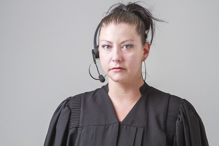 thirty something: thirty something woman, wearing a preacher robe and phone headset
