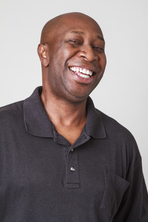 forty year old bald black man laughing