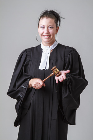 thirty something: thirty something lawyer woman bashing a gavel in her hand Stock Photo