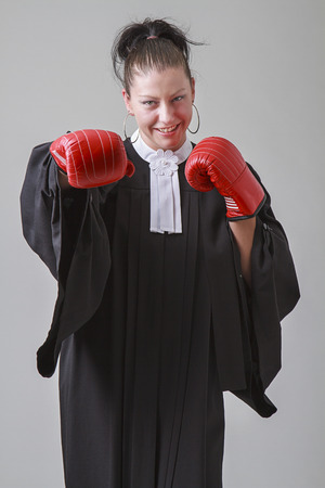 thirty something: thirty something lawyer woman throwing a punch