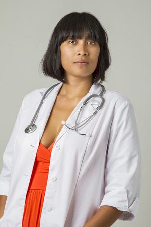 twenty something: twenty something asian woman wearing a lab coat and a stethoscope