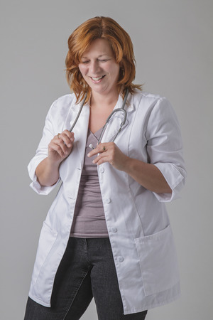 laughing out loud: woman doctor with red hair, laughing out loud