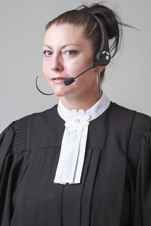 toga: La mujer llevaba toga abogado canadiense y un auricular de tel�fono