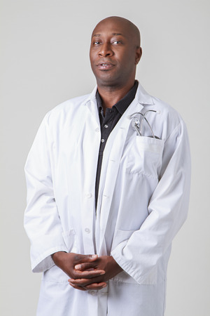 bald black man wearing a lab coat and stethoscope