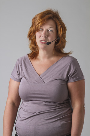 forty something: forty something female phone agent rolling her eyes