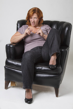 woman on couch: fortie something woman with maniacle expression