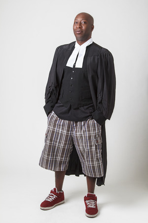 old black man: Bald forty year old black man wearing bermuda and canadian lawyer toga