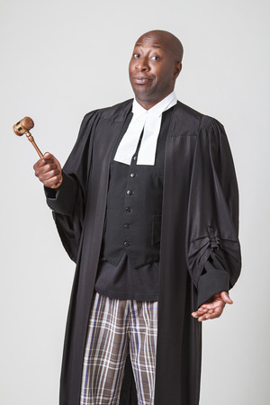 bald men: african american bald men wearing a lawyer toga with questionning expression Stock Photo