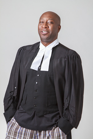 forty something: forty something, bald, african american wearing a canadian lawyer toga