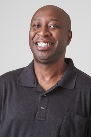 bald black men in his forty with great big smile