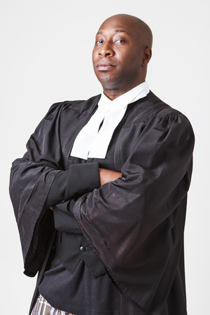 toga: bald black men in his forty wearing a canadian lawyer toga Stock Photo