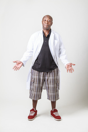 old black man: forty year old black man wearing a lab coat with his arm open and palm out with an expression of ignorance