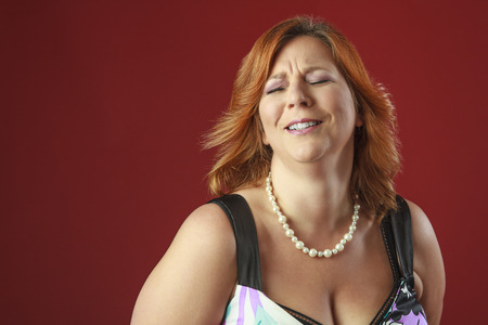 forties: woman in her forties, forcing a laugh Stock Photo
