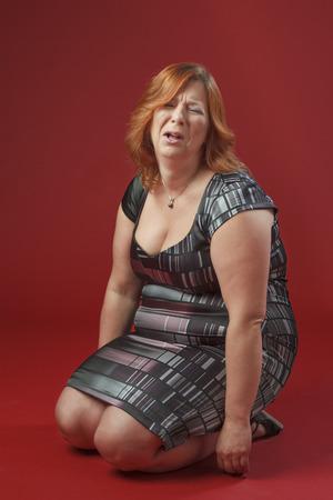 tantrum: red hair woman, on her knees, throwing a tantrum