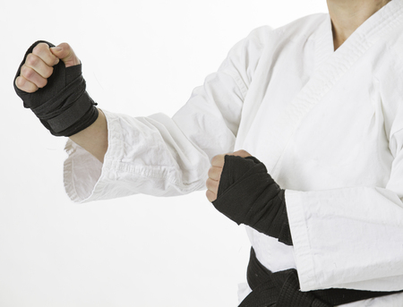 Woman hands wrap in black boxing strap, in fighting stance