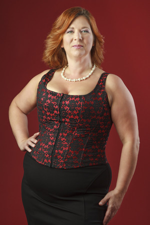 Plus size woman wearing a red corset
