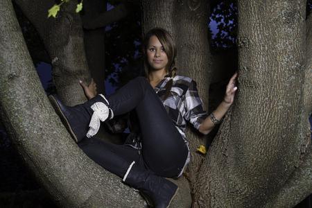 twenty something: twenty something girl sitting on a tree branch