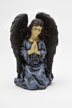 adoring: vintage angel figure of the christmas nativity scene Stock Photo