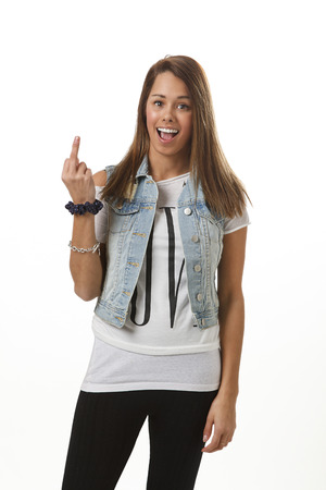 twenty something girl in trendy outfit, presenting the middle finger 版權商用圖片