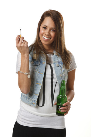 twenty something girl in trendy outfit, with a cigarette and a green bottle of beer