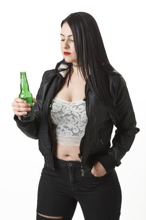 twenty something: twenty something girl looking at a beer bottle