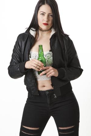 twenty something: twenty something woman holding a green bottle of beer