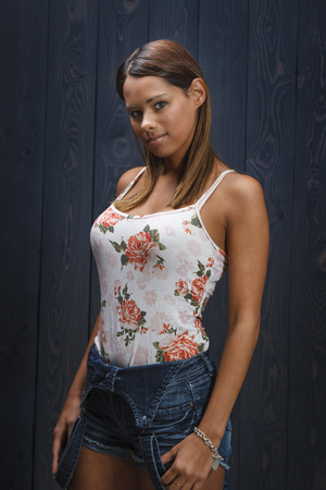 stunningly: stunningly beautiful young woman wearing a flowered pattern tank top and denim short