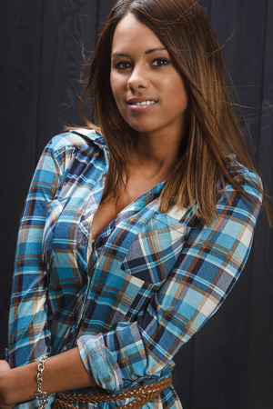 low cut: sexy tan woman with low cut plaid shirt Stock Photo