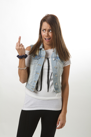 young woman flipping the bird with surprise expression