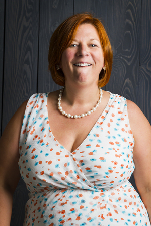red hair woman, in her forties, making a funny face