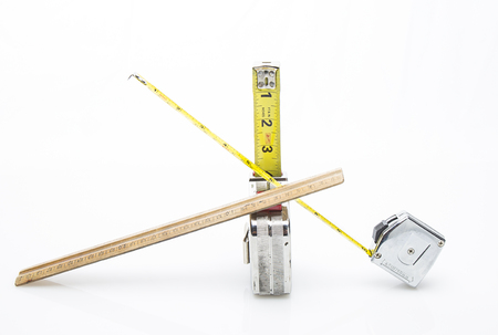 one wood ruler and two short tape mesuring tape isolated on a white background