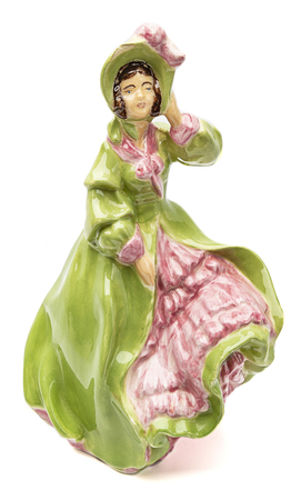 isolated porcelain figurine of a southern belle Stock Photo