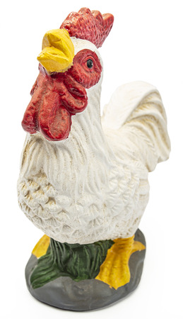 Small chicken figurine isolated on white background